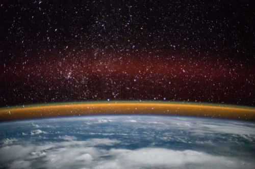 ESA (European Space Agency) astronaut Samantha Cristoforetti captured this image while on the International Space Station. It shows cloud cover over England, Baltic Sea and the Persian Gulf. It also displays a golden aurora with a splash of red through the stars during the night of Dec. 15, 2014.