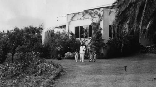 Mann and his family outside their San Remo Drive home. Source.